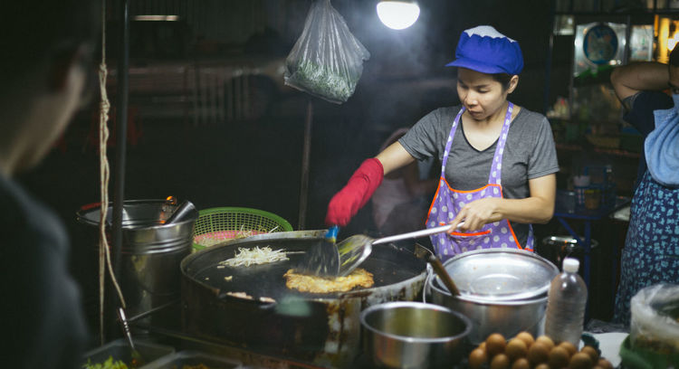 Street cooking in Bangkok, Thailand Adult ASIA Bangkok Cap Cooking Day Food Food And Drink Freshness Holding Indoors  Making Night People Preparation  Preparing Food Real People Standing Street Photography Streetfood Streetphotography Thai Thailand Women Working