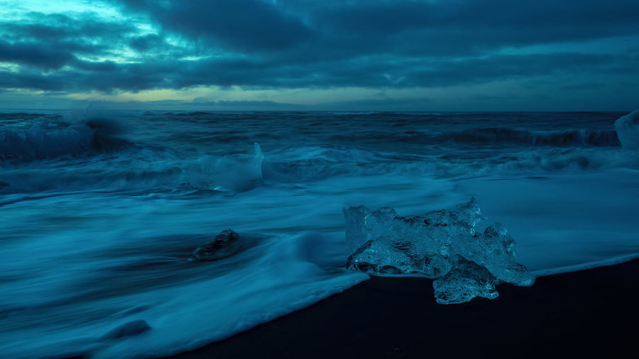 Aerial view of frozen sea against sky