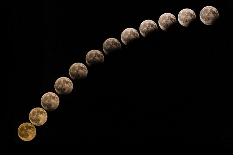 Moon cycle against clear sky at night