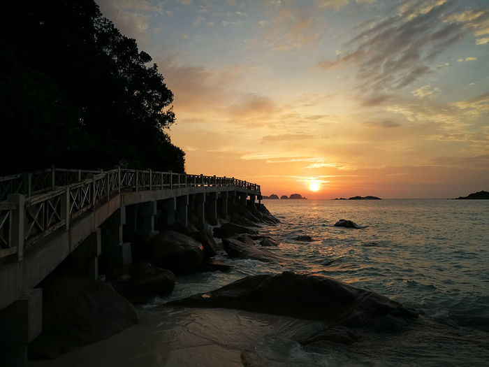 Sunset in Redang. Sky Water Sunset Sea Scenics - Nature Beauty In Nature Architecture Built Structure Cloud - Sky Nature Land Beach Bridge No People Tranquility Tranquil Scene Rock Orange Color Solid Bridge - Man Made Structure Horizon Over Water Outdoors