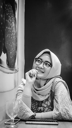 Sitting One Person Portrait Young Adult Young Women Eyeglasses  Indoors  EyeEmNewHere Daily Life Headscarf Hijabstyle  Young Woman In Bw Series In Bw Definatalia