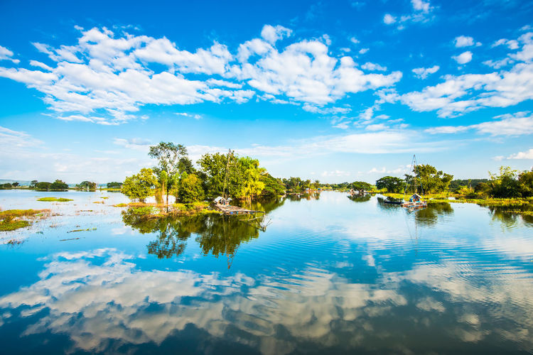 Water Sky Cloud - Sky Reflection Tranquility Beauty In Nature Scenics - Nature Tranquil Scene Lake Tree Plant Nature Waterfront No People Idyllic Blue Day Non-urban Scene Outdoors
