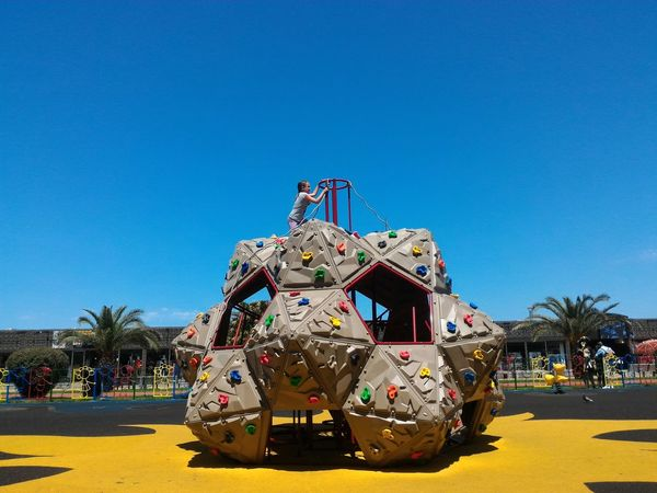 Playground, colours of game Girl Child Alone Climb Yellow Color Blue Color Summertime Summer Game Travel Photography City Life Clear Sky Arts Culture And Entertainment Amusement Park Gambling Sky