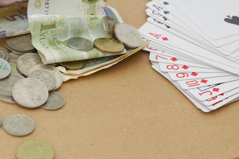 Gambling concept Money Copy Space Copy Space Wooden Background Money Glass Jar Savings Gambling Playing Card Cards Currency Summer Beach High Angle View Close-up Poker - Card Game Ace Dice Luck Piggy Bank