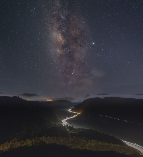 Scenic view of mountain against sky at night
