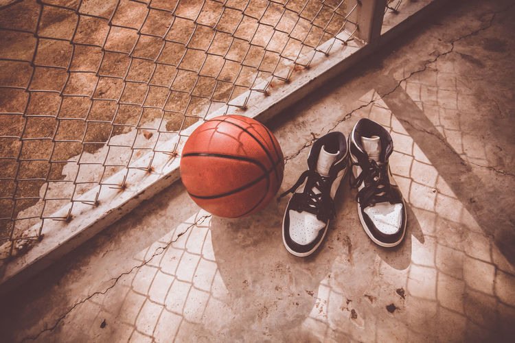 Ball Shoe Sport High Angle View Flooring Basketball - Ball Indoors  Basketball - Sport No People Leather Court Still Life Pair Day Sports Equipment Team Sport Absence Bag