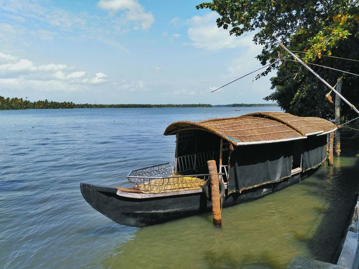Country boat on Kerala backwaters Water Sky Tree Tranquil Scene Lake Boat Transportation Tranquility Nautical Vessel Scenics Nature Sea Vacations Calm Outdoors Waterfront Beauty In Nature Day Non-urban Scene Summer India Take Over Contrast Beauty In Nature Nature Tranquility