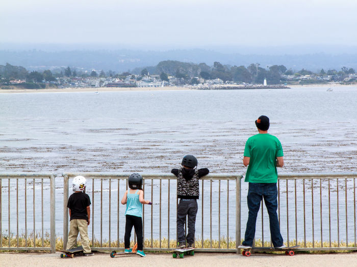 Sunday is Family Day Casual Clothing Children Photography Family Familyday Father Father & Son Helmet Helmets Kids Sports Kidsphotography Leisure Activity Lifestyles Looking At View Rear View Safety First! Sk8 Sk8orDie Sk8ter Boy Sk8ter Girl  Skateboarding Sports Photography Style Sunday Water