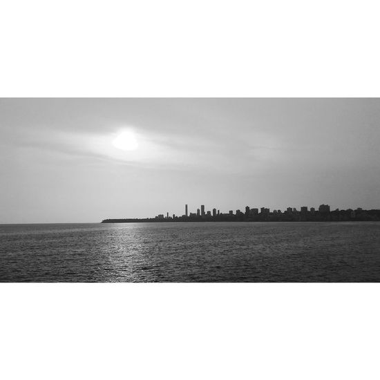 The Great Outdoors - 2017 EyeEm Awards Mumbai MumbaiDiaries Mumbai_uncensored Marinedrive Sunset Black And White Mobilephotography MotoClick Sea Sky Outdoors Water City Horizon Over Water No People Nature Day Beauty In Nature Clear Sky