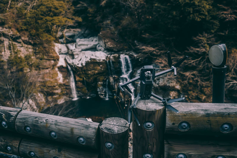 // chilling by the waterfall // Drone  Fun Funny Hilarious AMPt_community Wood - Material No People Focus On Foreground Nature Day Wood Outdoors Metal Transportation Close-up Selective Focus Equipment Old Table Log Built Structure High Angle View Architecture Refreshment Forest Humanity Meets Technology