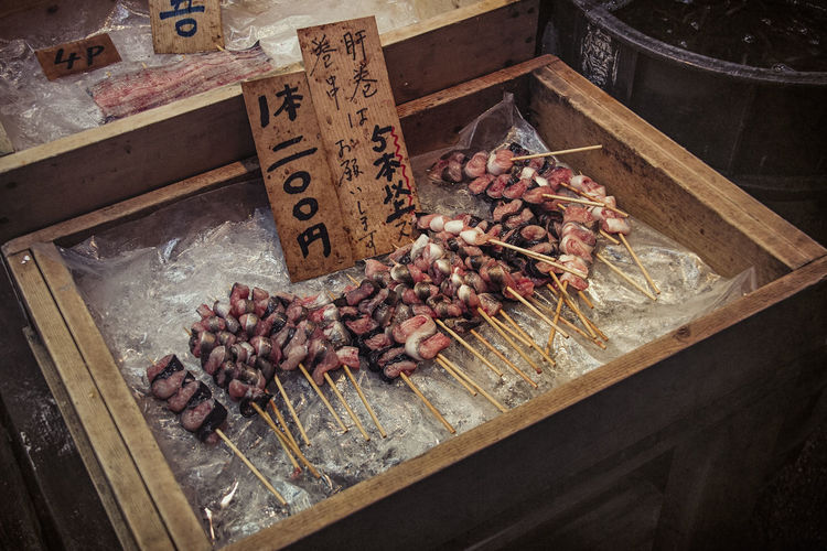 Japanese Food Tokyo,Japan Abundance Choice Close-up Day Fish Market Food Food And Drink For Sale Freshness Healthy Eating High Angle View Indoors  Large Group Of Objects Market Market Stall Meat No People Price Tag Raw Food Retail  Seafood Tray