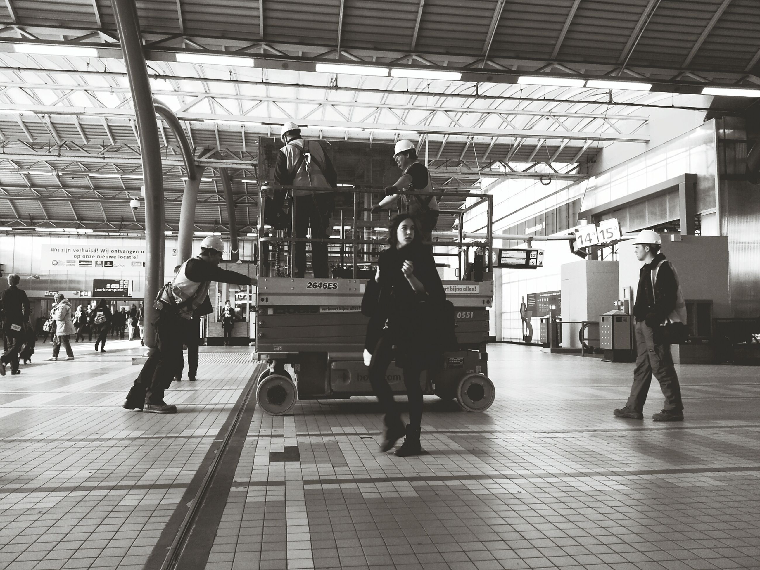 indoors, railroad station, lifestyles, public transportation, transportation, railroad station platform, full length, passenger, men, person, built structure, architecture, leisure activity, travel, city life, subway station, ceiling, walking