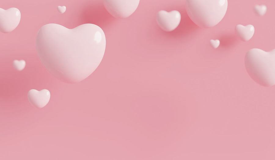High angle view of heart shape over pink background