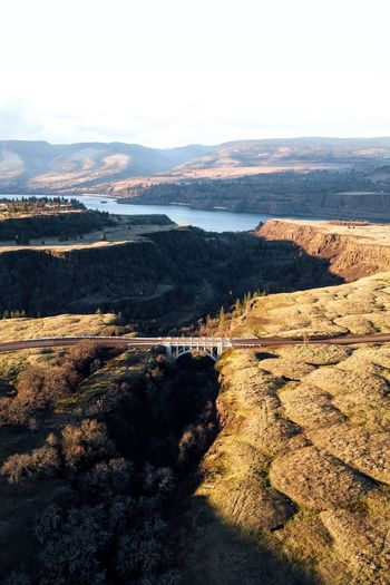 Bridge between plateaus. Rowena plateau, Oregon (IG @noeldxng) Plateau Aerial View Drone  Oregon Vista View From Above PNW Dji Exploring Road Outdoors Travel Destinations Tourism Sunset America View Oregon Mountain Water Arid Climate Beach Sky Landscape Arid Landscape Arid Barren Depression - Land Feature Mountain Range Extreme Terrain Dramatic Landscape