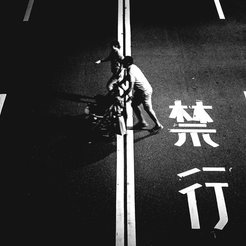 Low section of man skateboarding on road