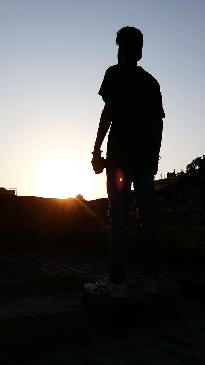 sunset, one person, silhouette, standing, real people, full length, sky, outdoors, men, clear sky, lifestyles, nature, beauty in nature, one man only, day, people