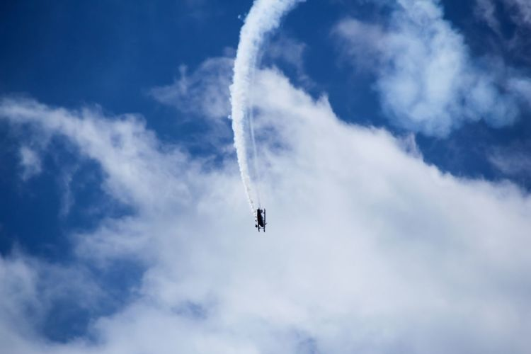 Air show Aerobatics Air Vehicle Airplane Airshow Blue Cloud - Sky Day Fighter Plane Flying Low Angle View Military Airplane No People Outdoors Performance Sky Smoke - Physical Structure Speed Teamwork Transportation Vapor Trail