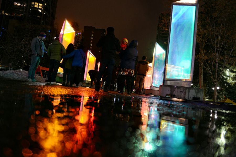 Reflection Night Illuminated City People Family Outdoors Annual Event Participant Urban Cold Temperature The City Light Glow Glow In The Dark Multi Colored Cold And Warm Colours@ YYC Yyc Calgary Alberta Canada Calgary Winter Light Festival
