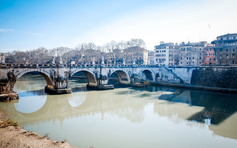 Ponte sant angelo over tiber river by residential district