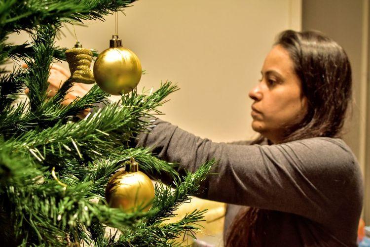 Woman on christmas tree