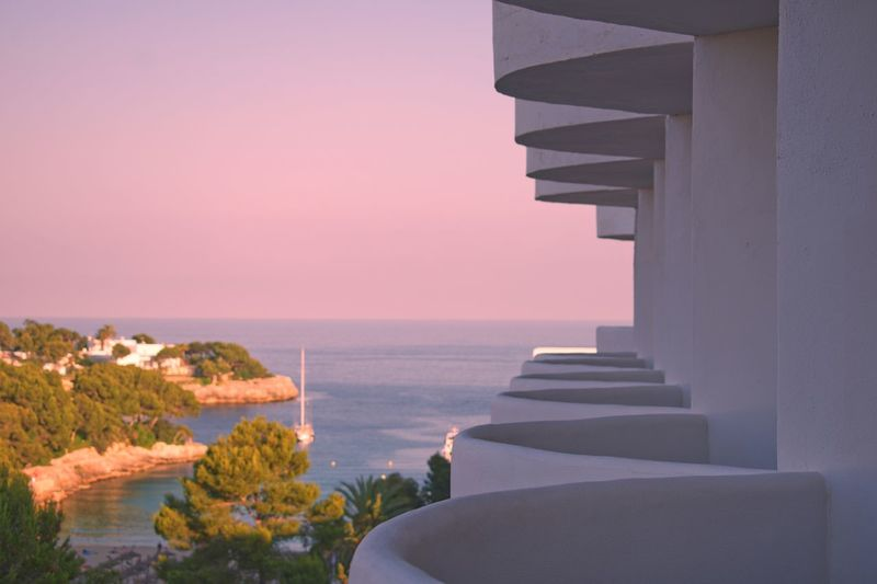 Hotel Balcony's leading to the beach Balcony Balcony View Water Sea Sky Beauty In Nature Nature Architecture Sunset Built Structure Scenics - Nature Architectural Column Direction Tranquility Horizon Over Water No People Horizon Beach Tranquil Scene Clear Sky