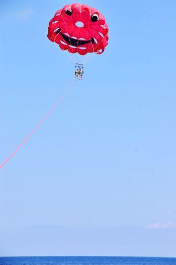 Parasailing on Agios Nikolaus Bay, Zakynthos Zakynthos Island Zakynthos Blue Sea... Wonderful Nature Sea Life Sea Agios Nikolaus Parasailing Emotions Flying Red Airshow Mid-air Blue Balloon Aerobatics Sky