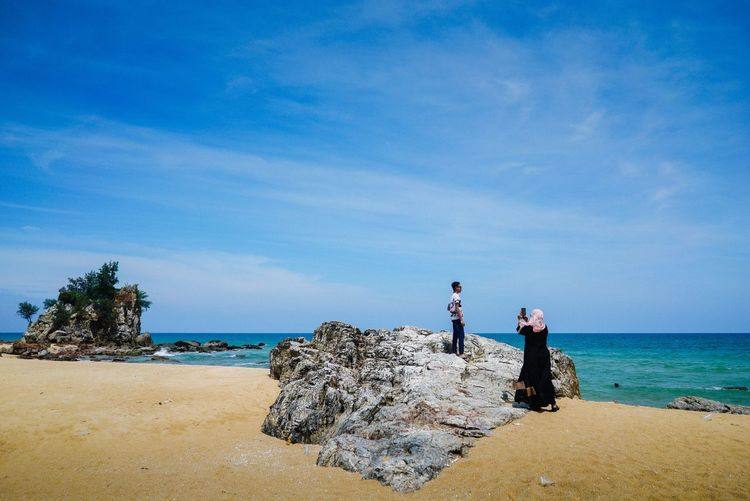 Blue Sky Sea Beach Horizon Over Water Real People Sky Water Nature Two People Standing Scenics Rock - Object Full Length Outdoors Men Day Beauty In Nature Leisure Activity Lifestyles Blue Young Adult