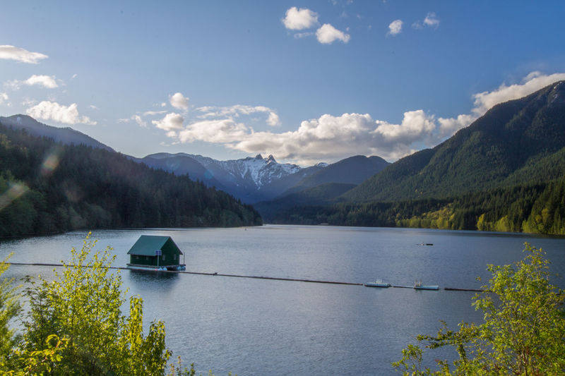 Beauty In Nature Boathouse British Columbia Canada Cloud - Sky Color Image Day Lake Mountain Mountain Range Nature No People North Vancouver Outdoors Photography Scenics Sky Snowcapped Sunny Tranquil Scene Tranquility Transportation Tree Water