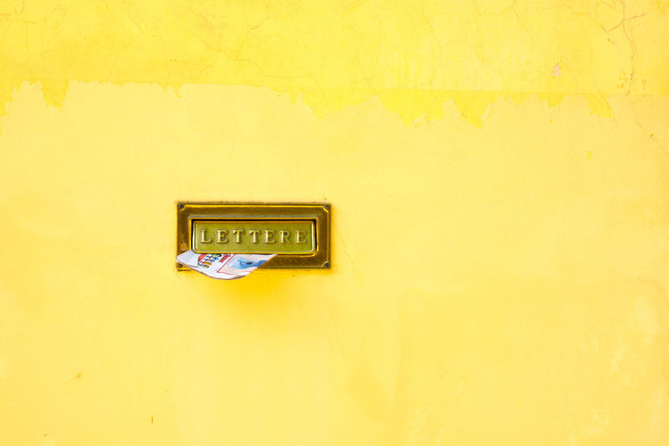 Yellow Wall - Building Feature Postbox No People Italy IT Postprocessing Vibrant Color Wall Yellow Wall - Building Feature Close-up Architecture Green Color Full Frame Day Blue Outdoors Geometric Shape No People Vibrant Color