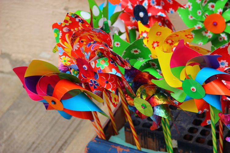 Close-up of colorful pinwheel toys for sale at street market