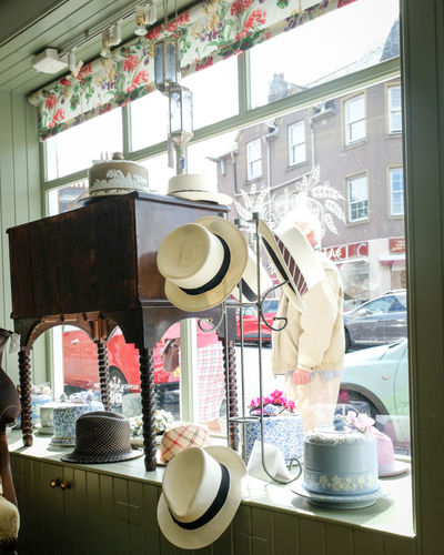 Business Container Couture, Fashionable, Crockery Cup Day Freshness Glass - Material Hats, Straw Hats, Sunshade, Gloves, Protection Hatshop Indoors  Kitchen No People Plate Restaurant Retail  Retail Display Still Life Sweet Transparent Window