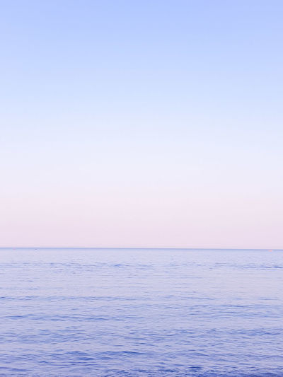 Sea Horizon Over Water Beach Blue Tranquility Scenics Sunset Water Tranquil Scene Nature Landscape Beauty In Nature Vacations Copy Space Idyllic Clear Sky Sky Outdoors No People Rippled