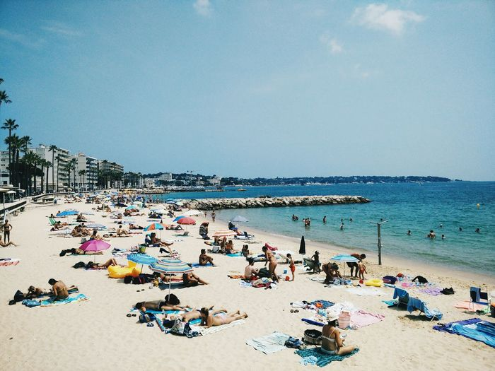 Beach Sea Sand Vacations Large Group Of People Summer Water Outdoors Horizon Over Water Sky Day Fun Nature Leisure Activity Travel Destinations Relaxation People Crowd Swimming Beauty In Nature Antibes France