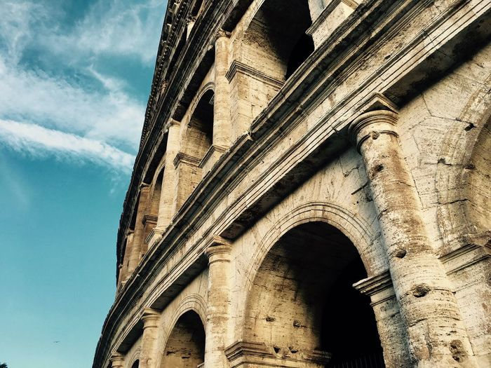 Low angle view of colosseum against sky
