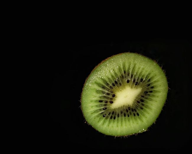 Close-up of fruit against black background