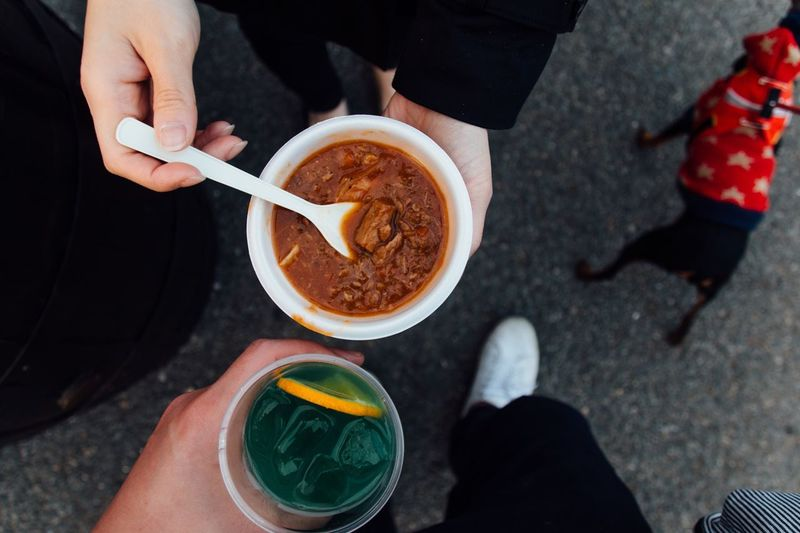 Cropped Image Of People With Food And Drink On Street