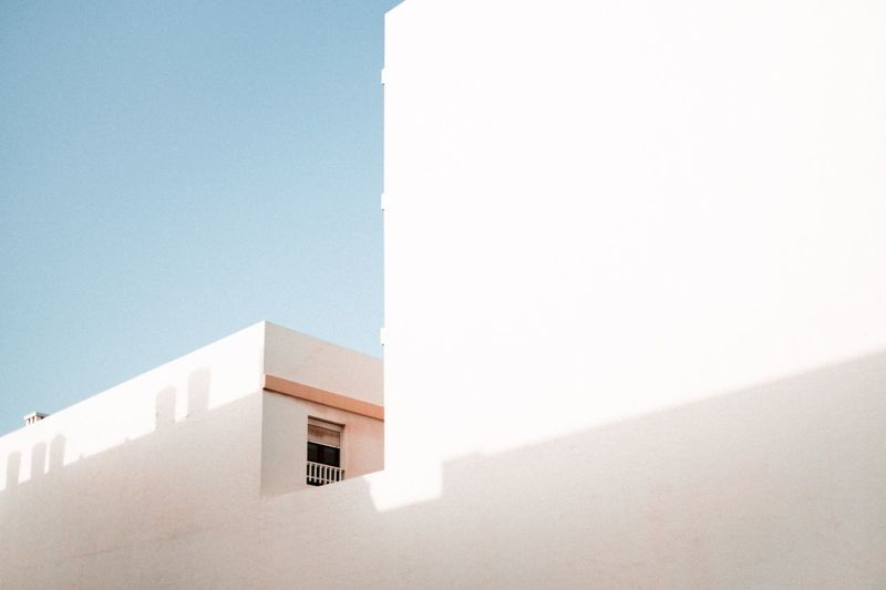 Minimalism architecture Lanzarote EyeEm Best Pics Canary Islands Minimalism EyeEm Best Shots Morning City House EyeEm Selects Architecture Built Structure Building Exterior Wall - Building Feature Copy Space Sunlight Building Day Sky White Color Clear Sky Low Angle View Nature No People Whitewashed Outdoors Shadow Blue Wall Tower 17.62° My Best Photo The Architect - 2019 EyeEm Awards The Minimalist - 2019 EyeEm Awards