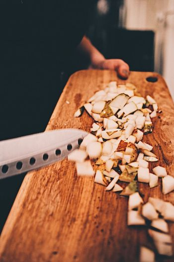 Food Wood - Material Food And Drink Table Healthy Eating Indoors  Freshness Walnut No People Close-up Cutting Board Cutted Cutted Food Cuttingboard Hand Knife Cooking Cooking At Home Food Ingredients Wooden Knife Indoors  Fruits