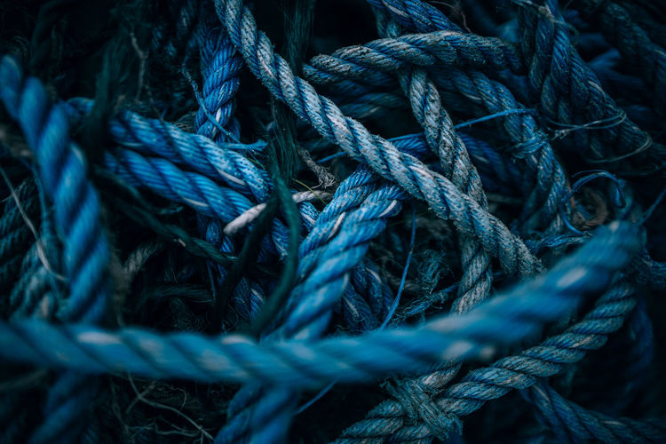 Close-up high angle view of tangled blue ropes