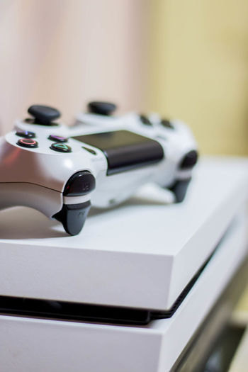 PS4 PS4 Arts Culture And Entertainment Business Close-up Day Equipment Focus On Foreground Group Of Objects High Angle View Indoors  Man Made No People Office Office Supply Order Ps4 Controller Retro Styled Security Selective Focus Silver Colored Still Life Table White Color