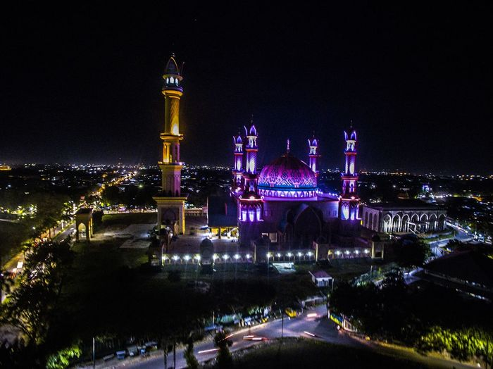 High angle view of illuminated lombok masjid amidst cityscape at night