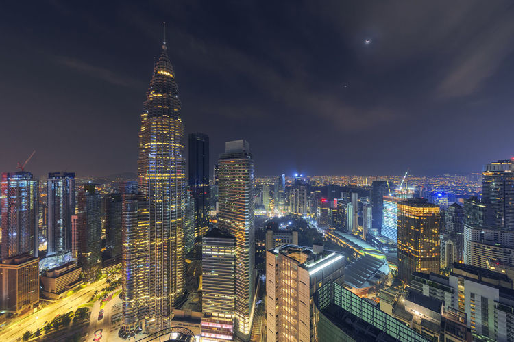 Kuala Lumpur city, aerial view at night. Kuala Lumpur Klcc Malaysia Astronomy Building Exterior Architecture Urban Skyline Lifestyles Life Built Structure Beauty In Nature Hanging Out High Angle View No People Nature Night Tree Tranquility Tranquil Scene Tower City Cityscape Sky Skyscraper Road Close-up Cloud - Sky