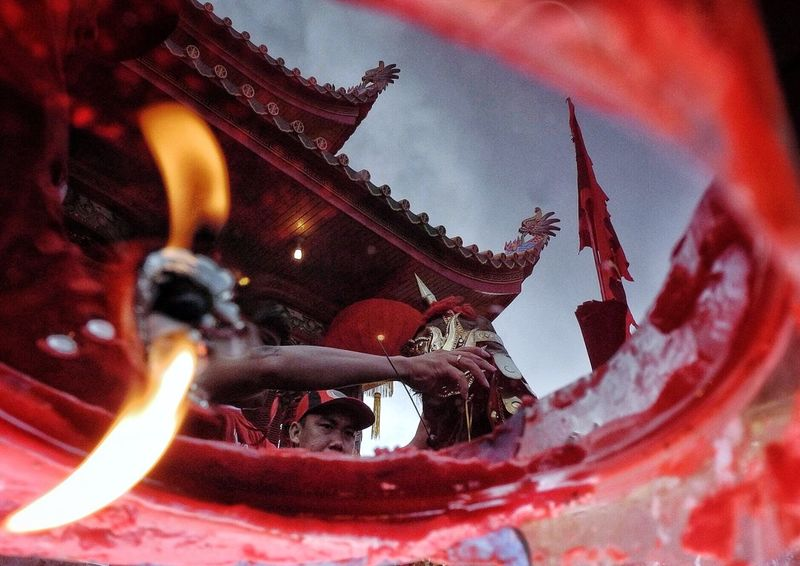 Tatung preparing ceremony Chinese Culture Capgomeh Singkawang Tatung Illuminated Red Religion Low Angle View Nature No People Spirituality Flame Built Structure