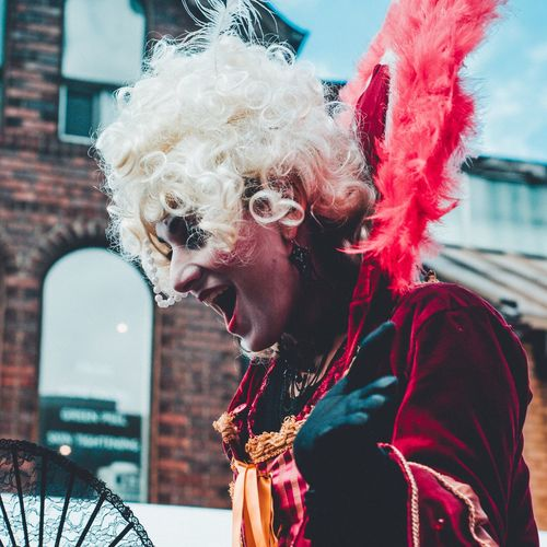 Festivalfashion Costume Stilt Walkers Real People Leisure Activity Mid Adult Men One Person Mid Adult Lifestyles Architecture