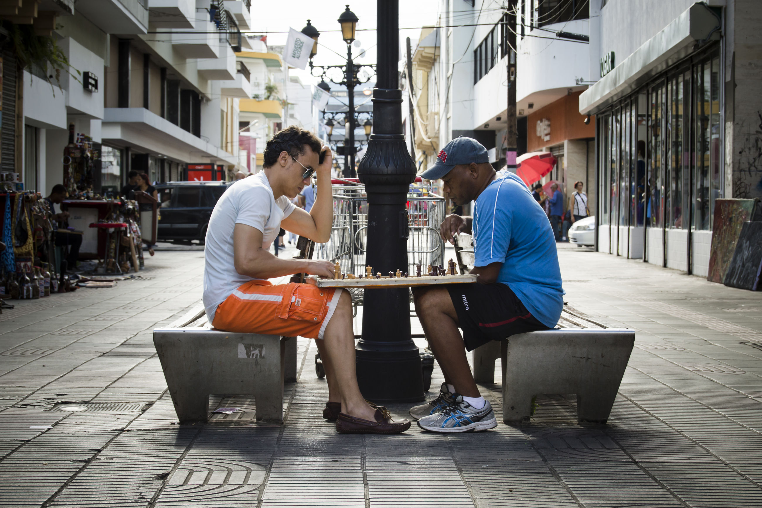 real people, sitting, two people, full length, building exterior, casual clothing, day, built structure, architecture, togetherness, outdoors, men, playing, young adult, friendship, city, people