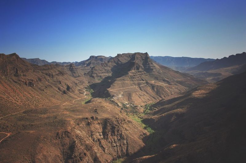 Scenic view of rocky mountains against clear sky at gran canaria
