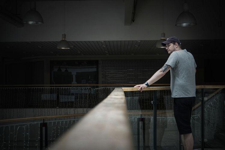 Full length of man standing on railing