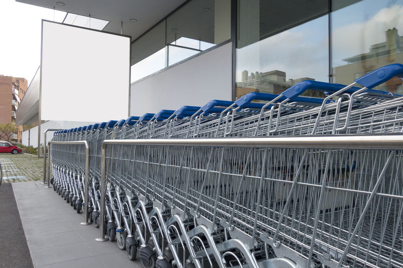 Blank billboard with shopping carts in a supermarket In A Row Architecture Built Structure No People Empty Day Metal Absence Cart Shoping Shoping Cart Supermarket Mall Shoping Mall Blank Billboard Advertisement Advertising Mock Up Mockup Poster Marketing Offer Discount Shopping Shopping Cart