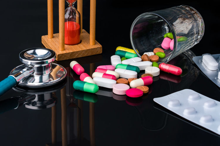 Close-up of multi colored pencils in jar on table