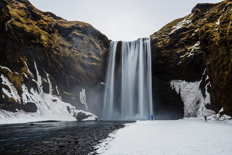 Scenic view of skogafoss waterfall during winter